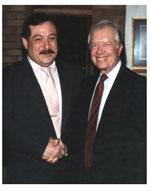 Avram C. Freedberg shakes hands with former President Jimmy Carter at Congregation Agudath Sholom.