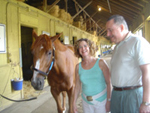Avram C. Freedberg, his wife, Rhoda, and Ahvee's Destiny heading back to the stable in the shed row.