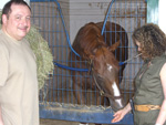 Rhoda Freedberg gives Ahvee's Destiny a carrot, while Avram looks on, June 2008.