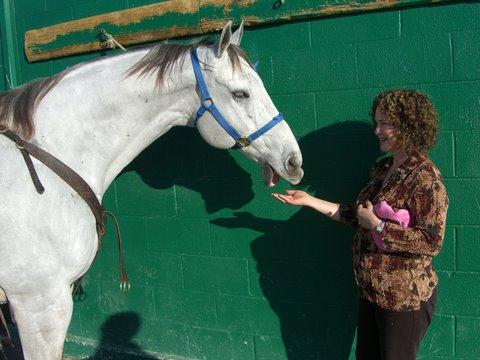 Rhoda feeding Rachel's pony, Dakota.